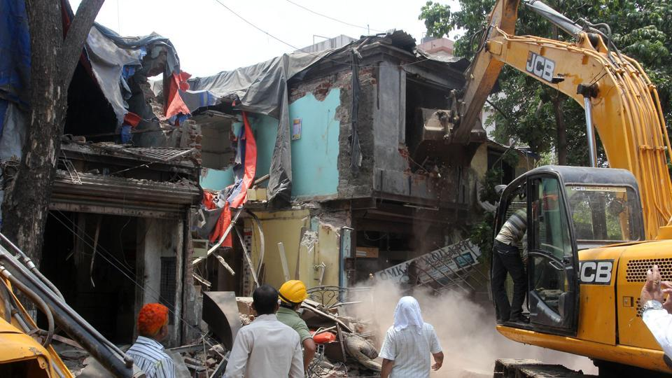 Acting on the orders of the town and country planning , district town planner officials demolished more than 50 unauthorised structures in four hours.