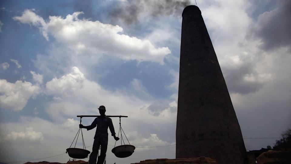 A worker carries coal to a kiln at a factory in Bhaktapur. Under skies darkened by thick black smoke, hundreds of thousands of brick kiln workers endure back-breaking labour, suffocating heat and archaic conditions across South Asia. But in Nepal, the need to rebuild after the devastating 2015 earthquake has presented an unexpected opportunity to decrease emissions, increase efficiency and make the kilns safer. (Gopen Rai / AFP)