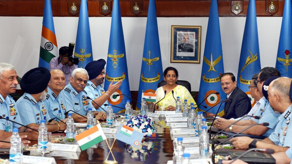 Defence Minister Nirmala Sitharaman (C) with Air Chief Marshal Birender Singh Dhanoa (5th from left), Minister of state for defence Dr. Subhash Ramrao Bhamre (R) and others during the Indian Air Force Commanders Conference at Air Headquarters, Vayu Bhawan in New Delhi. (Arvind Yadav / HT Photo)