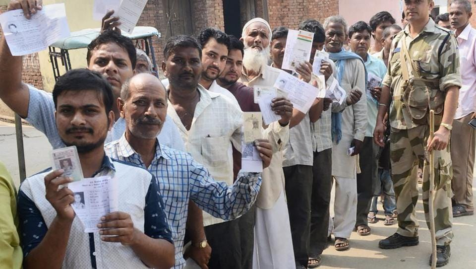 People queue up to cast their votes in Noorpur assembly bypolls in Bijnor on May 28, 2018.