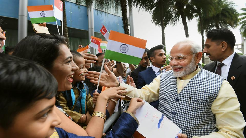 Prime Minister Narendra Modi being greeted by members of the Indian community on his arrival in Singapore on Thursday.