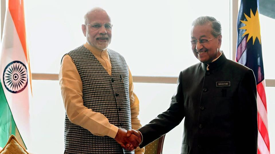 Prime Minister Narendra Modi greets his Malaysian counterpart Mahathir Bin Mohamad in Kuala Lumpur, Malaysia.  Modi's arrival in Malaysia marks the second phase of his five-day tour to Indonesia, Malaysia and Singapore. (PTI)