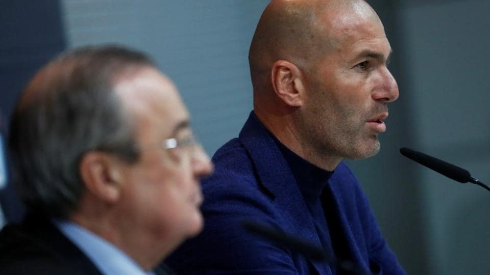 Zinedine Zidane announces his decision to step down as Real Madrid coach as club president Florentino Perez looks on in Madrid on Thursday.
