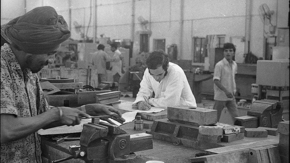 Maruti's 300 acre manufacturing unit in what was then land under rural villages in proximity with the national capital laid the seeds of industry. Soon allied part makers also began setting units in Maruti's vicinity and an industrial city began to take shape. (Babu Ram / HT Archive)