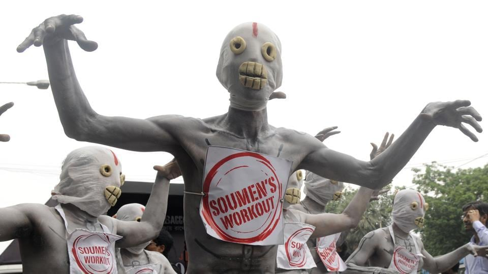 "Participants in an anti-tobacco awareness campaign march with costumed as skeletons during an event marking ""World No Tobacco Day"" at Esplanade in Kolkata. (Samir Jana / HT Photo)"