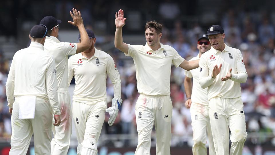 England's Chris Woakes, centre, celebrates taking the wicket of Pakistan's Hasan Ali during day one of the second cricket Test Match at Headingley in Leeds.