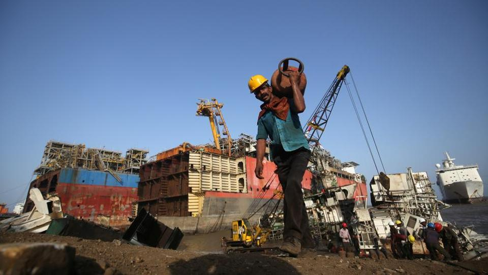 A worker carries a gas cylinder past decommissioned ships being dismantled at the Alang shipyard in the western state of Gujarat. Hit by a flood of cheap Chinese steel and new European Union environmental rules, more than half of the ship-breaking yards have shut in the past two years and the future of the trade in India and neighbours Bangladesh and Pakistan is bleak. (Amit Dave / REUTERS)