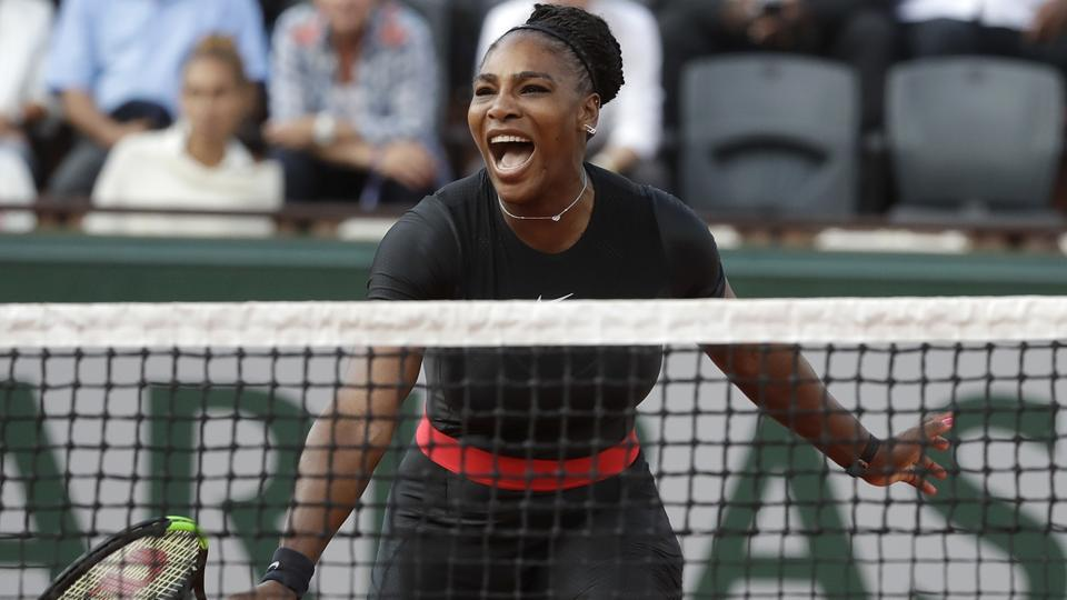 Serena Williams celebrates after her victory over Ashleigh Barty at the French Open on Thursday.