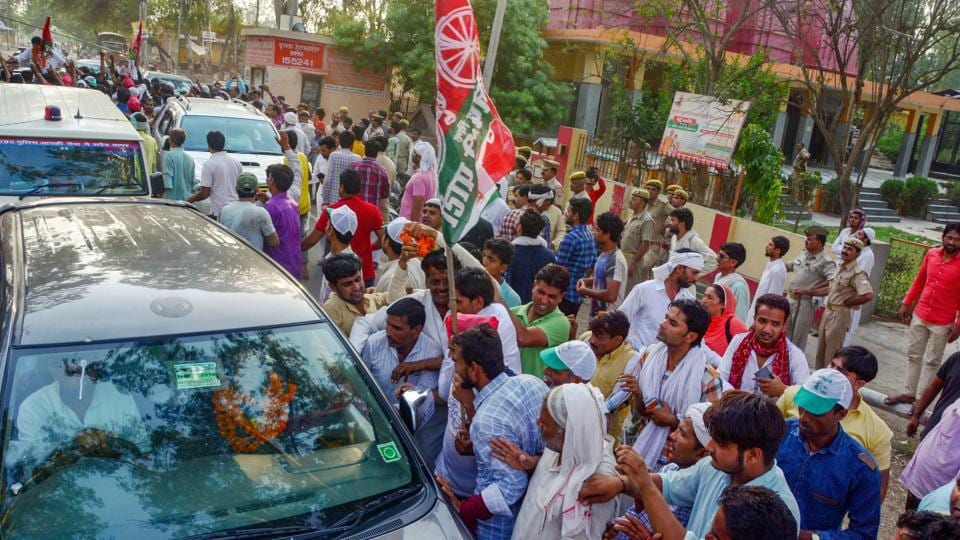 Supporters of Rashtriya Lok Dal candidate Tabassum Hasan outside a counting centre after winning the Kairana Lok Sabha by-elections in Kairana on May 3 1, 2018.