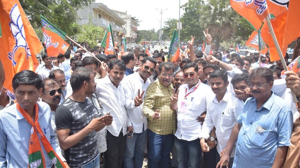 BJP supporters celebrate after winning the bypoll in Palghar.