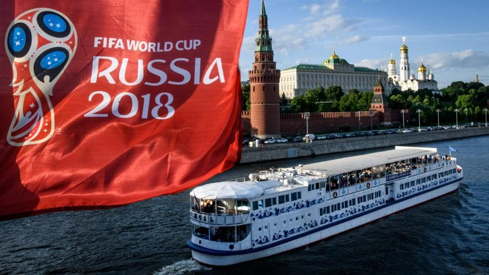 A FIFA World Cup 2018 flag sways  in front of the Kremlin in Moscow on May 30, 2018. (Mladen Antonov / AFP)