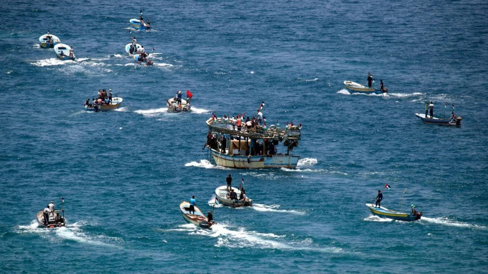Setting to sail from Gaza City harbour,  a group of Palestinian activists on fishing boats protest as they try to breach Israel's naval blockade on Gaza on May 29, 2018. (Thomas Coex / AFP)