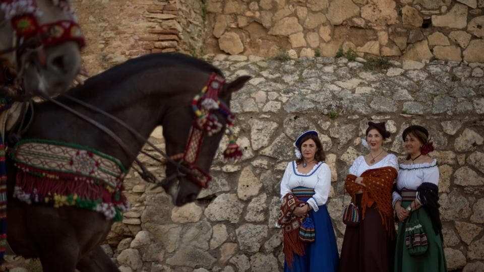 Women wearing traditional costumes take part in the re-enactment of a battle of the Spanish War of Independence (1808-1814) against France in Ronda, Spain on May 25, 2018. (Jorge Guerrero / AFP)