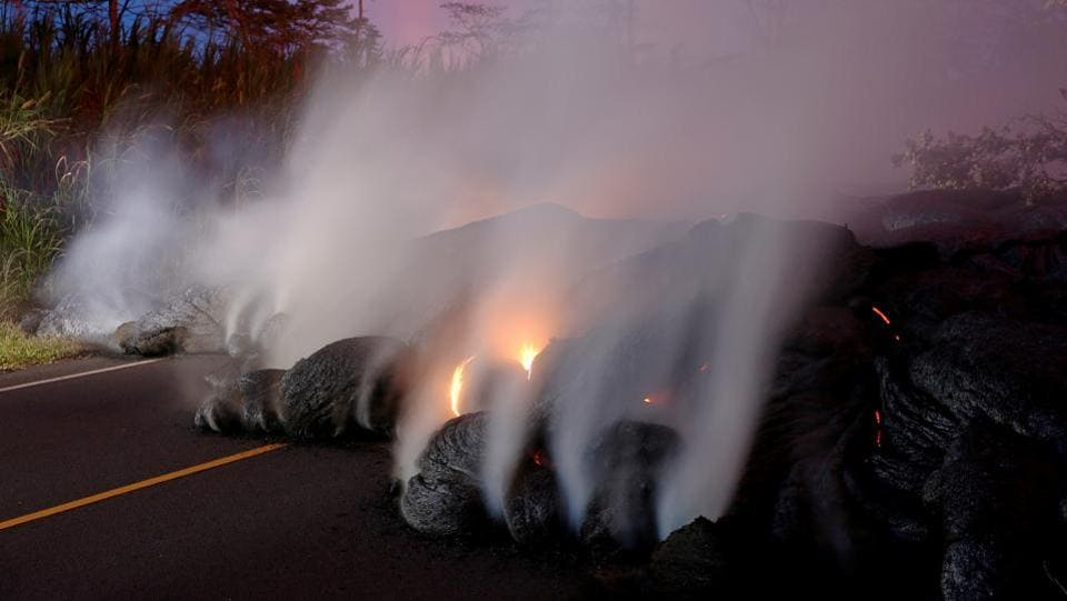 Volcanic gases rise from the Kilauea lava flow that crossed Pohoiki Road near Highway 132 near Pahoa, Hawaii on May 28, 2018. (Marco Garcia / REUTERS)