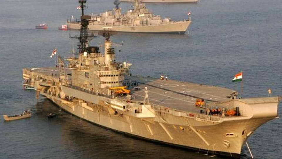 The Indian Navy's aircraft carrier Viraat (foreground) is anchored alongside other ships.