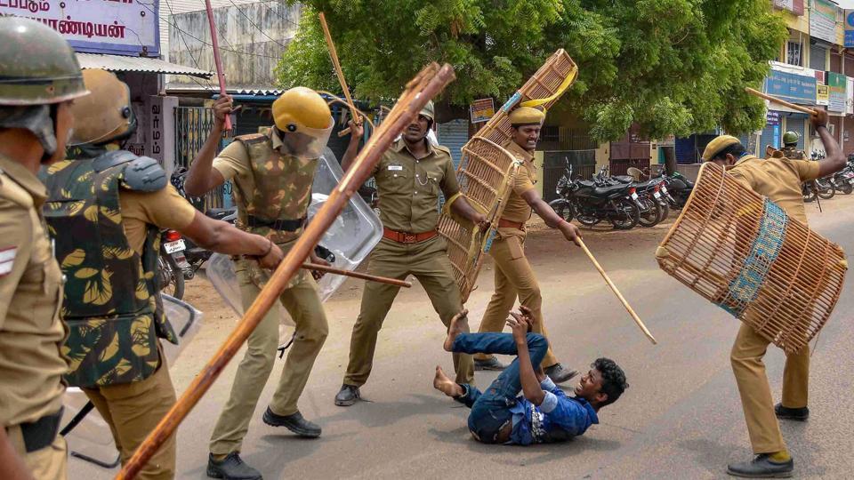 Police personnel baton charge at a protestor demanding the closure of Vedanta's Sterlite Copper unit, in Tuticorin.