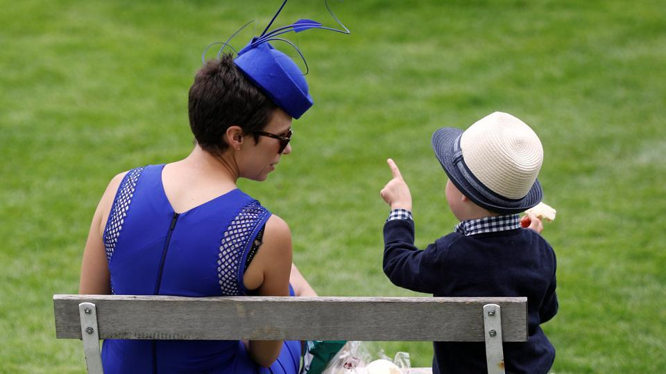 A little racegoer gets a crash course at the Epsom Derby.  (Peter Nicholls / REUTERS)