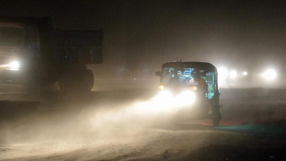 File photo of an auto rickshaw on a road during a dust storm in Mathura on May 2.
