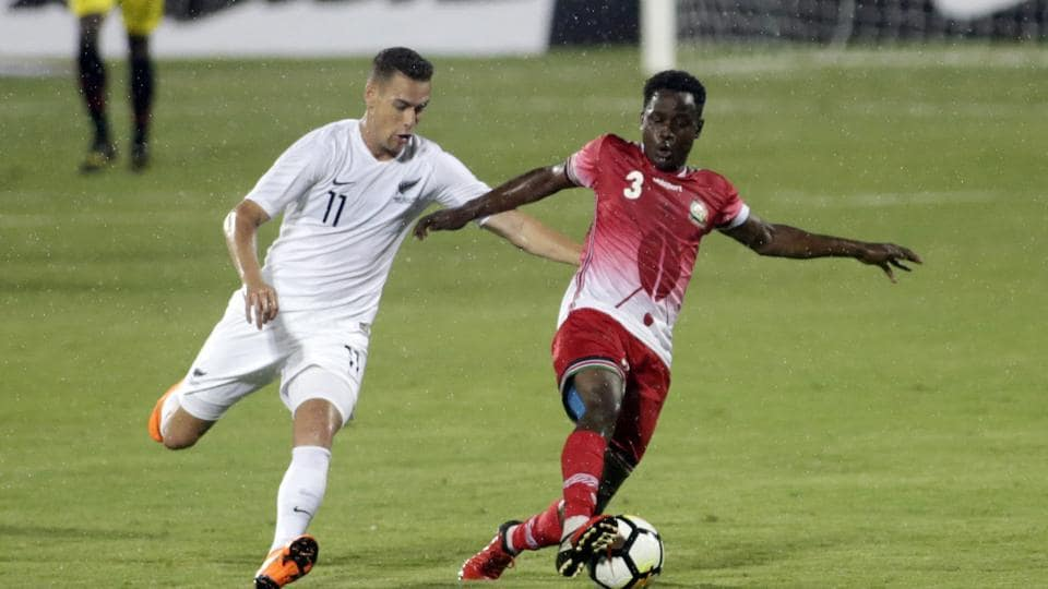 Kenya's football player Erick Ouma Otieno, right and New Zealand's Jai Emile Mau'u Ingham vie the ball during the Intercontinental Cup match.