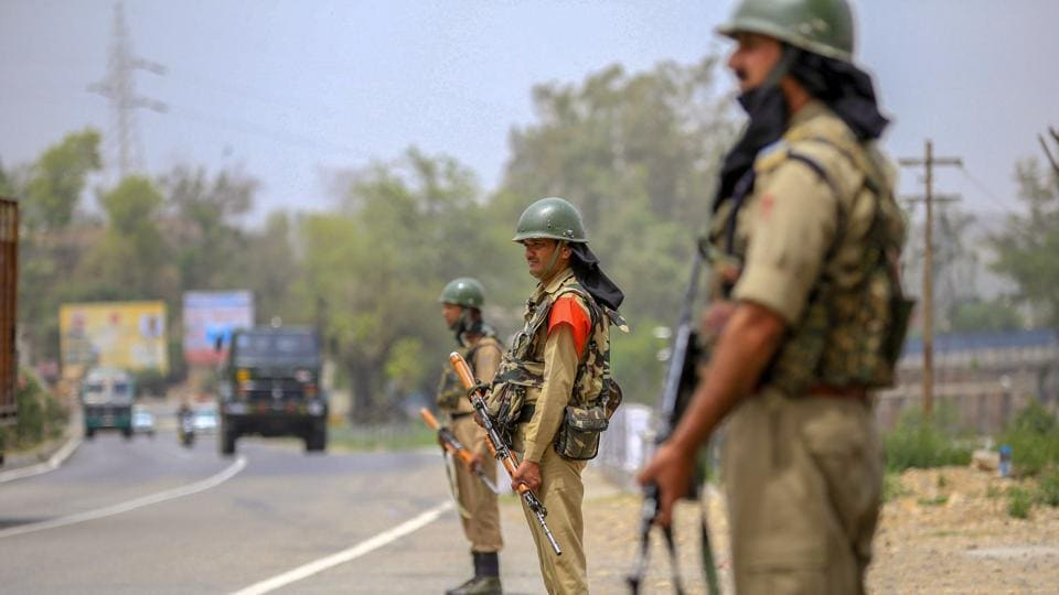 CRPF personnel keep vigil on Jammu-Srinagar National Highway, ahead of Prime Minister Narendra Modi's visit, near Nagrota in Jammu on Thursday.