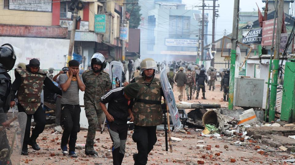 Security personnel stand guard a street during curfew in Shillong on Sunday.