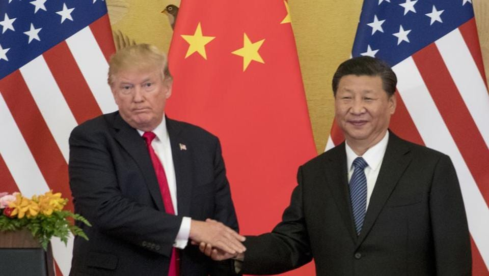 US President Donald Trump and Chinese President Xi Jinping shake hands during a joint statement to members of the media Great Hall of the People in Beijing, China.