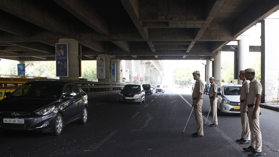 Gururgram Police on high alert at MG Road, after on three separate instances, thieves broke into three cars and stole laptops, cash and valuables worth Rs 5 lakh from posh areas, in Gurugram, India, on Sunday, June 3, 2018.