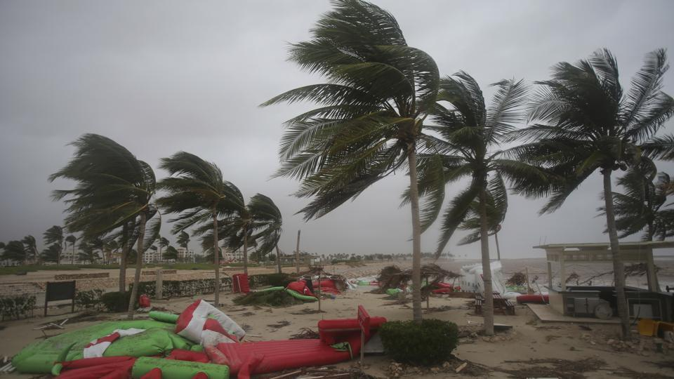 Debris litter a beach after Cyclone Mekunu in Salalah, Oman, Saturday, May 26, 2018.