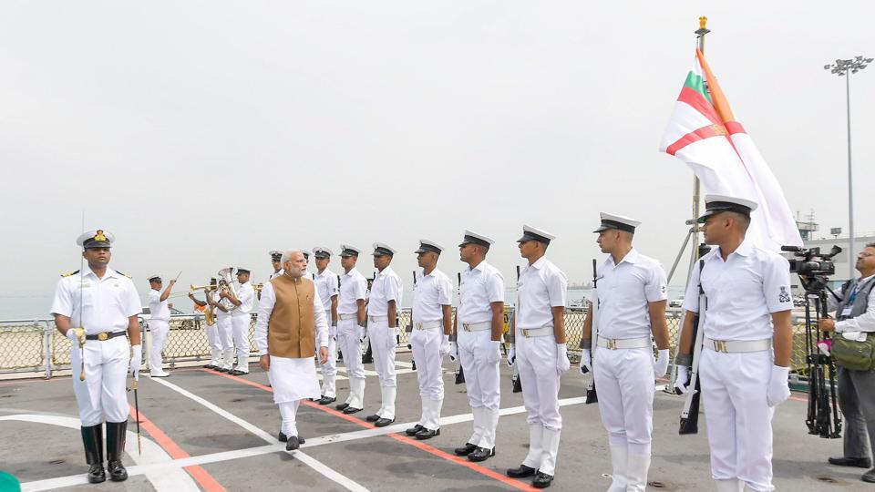 Prime Minister Narendra Modi inspects the guard of honour, presented to him at the Changi Naval Base, in Singapore on Saturday.