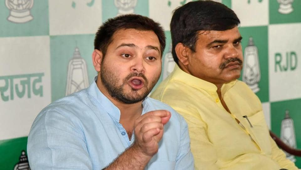RJD leader Tejashwi Yadav speaks to the media during a press conference in Patna.