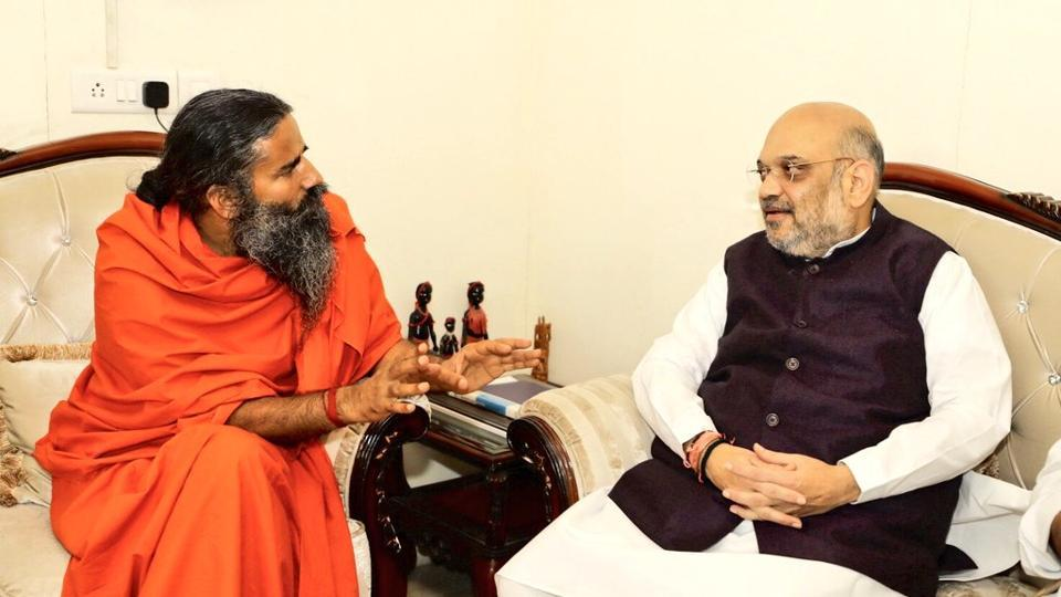 Bharatiya Janata Party president Amit Shah (right) with Yoga guru Ramdev, on Monday.