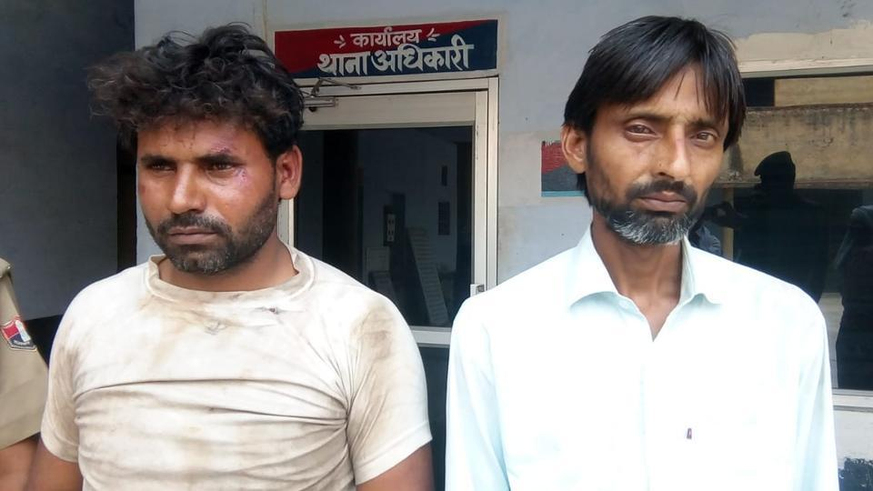 The cow smugglers in police custody.