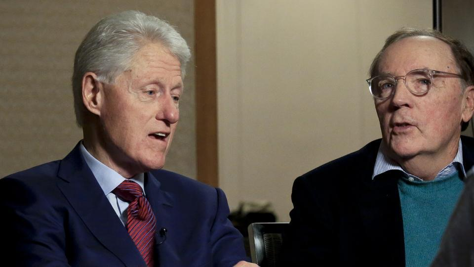 Former President Bill Clinton, left, listens as author James Patterson speaks during an interview about their new novel, 'The President is Missing,' in New York.