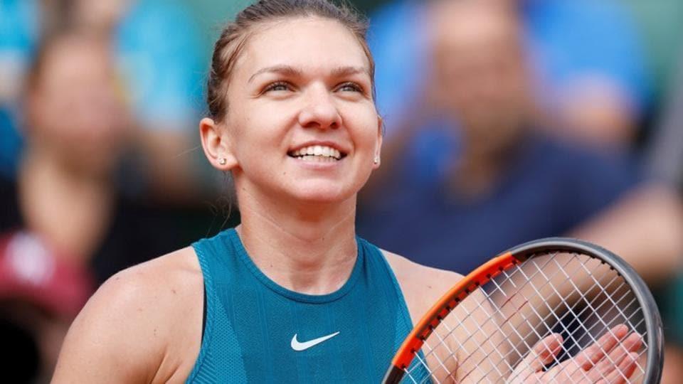 Simona Halep celebrates winning her French Open fourth round match against Elise Mertens on
