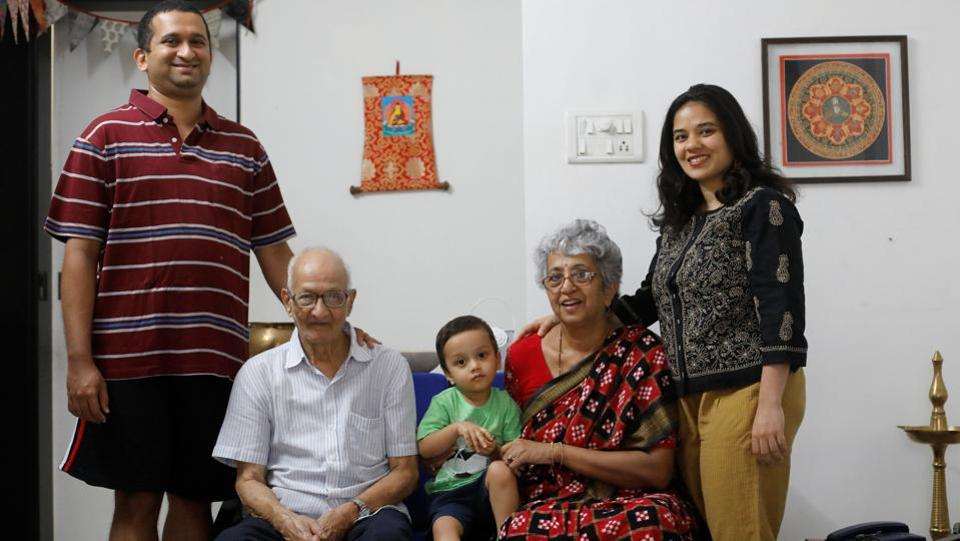 Mughda Joshi (R), along with her husband Tanmay Joshi (L), son Kabir (C), grandfather in law Manohar Joshi (2nd L) and mother in law Vandana Joshi (2nd R) pose for a portrait at their home in Mumbai. (Danish Siddiqui / REUTERS)
