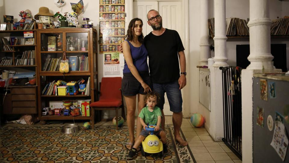 "Tatiana Schnittke (L), Yaniv Ben-Dov and their son Jonathan pose for a portrait in their apartment in Tel Aviv, Israel. For some, it is a personal battle, overcoming the preconceptions of others as they try to do their bit. ""They say 'are you part of this green movement' ... They don't understand it. Also not using plastic bags for vegetables is considered disgusting, they hate it ... but I still do it,"" Schnittke said. (Corinna Kern / REUTERS)"