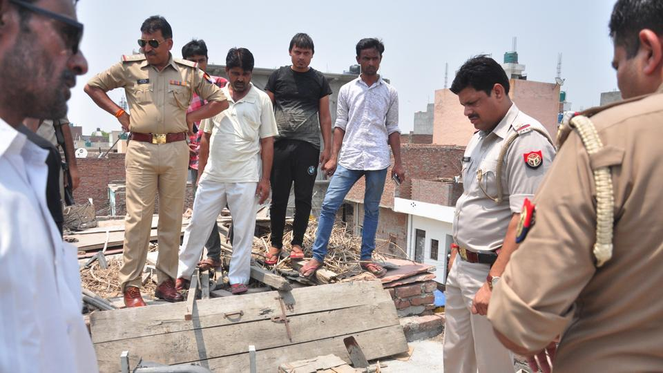 Police investigate at the spot where a body of a four-year-old boy was found inside a wooden chest on the rooftop of his neighbour's house - 18 months after he went missing on Sunday, in Ghaziabad, on Sunday.