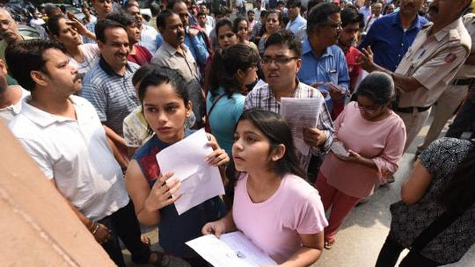 Students check the list before the CBSE National Eligibility-Cum-Entrance Test (NEET) medical entrance exam all over India at Bal Mandir School East Delhi , India, on Sunday.