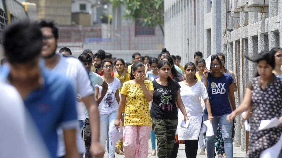 Students come out after appearing for the NEET exam.