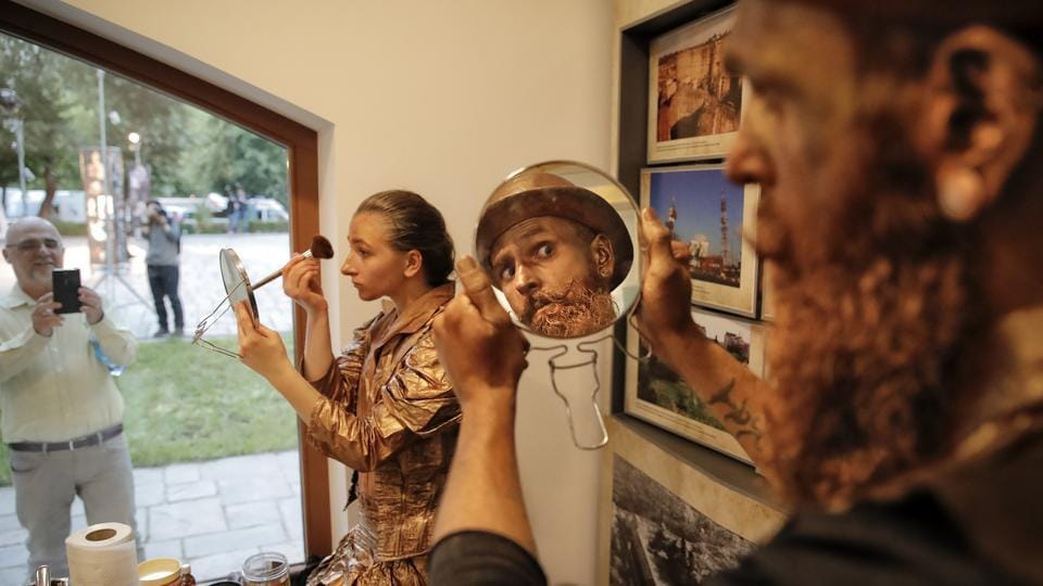 Ukranian artists apply make-up before heading out to perform in the Living Statues International Festival. Artists from eight countries embodied 64 statues in the old quarter of the Romanian capital, in popular parks and in the garden of the spectacular Filipescu-Cesianu residence, built in 1892 in the Belle Epoque period. (Vadim Ghirda / AP)