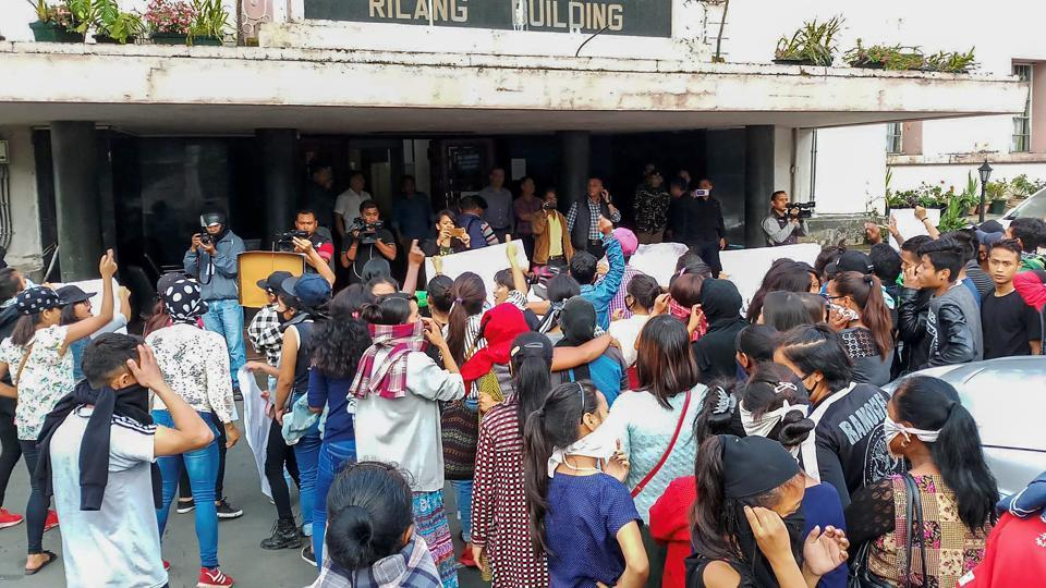 People from different parts of the city stage a protest Meghalaya Secretariat during curfew, in Shillong on Monday, June 04, 2018. )
