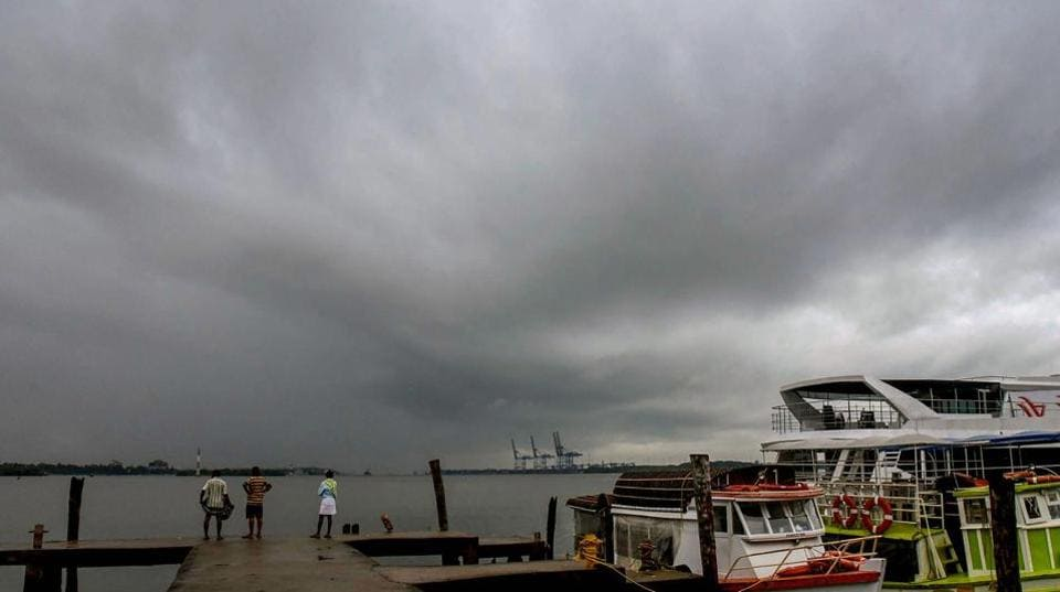 People look on as dark clouds hover over the coast with the onset of southwest monsoon in Kochi on Monday. Rainfall has occurred at most places over Karnataka, Kerala, Lakshadweep, at many places over Rayalaseema, Telangana, a few places over Tamil Nadu and at isolated places over coastal Andhra Pradesh. (PTI)