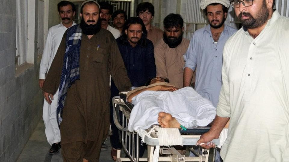 People carry injured Pashtuns to hospital.
