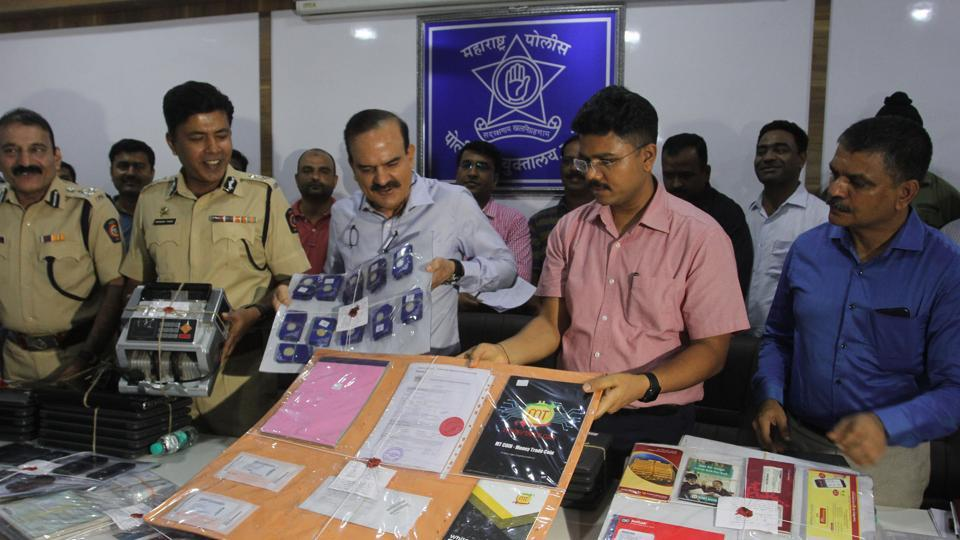 Thane crime branch officers display evidence obtained from Flinstone Group, implicated in a multi-crore scam