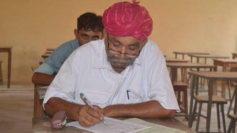 Elderly villagers appear for the class 8 examination at the Kota Open University in Barmer on Tuesday.