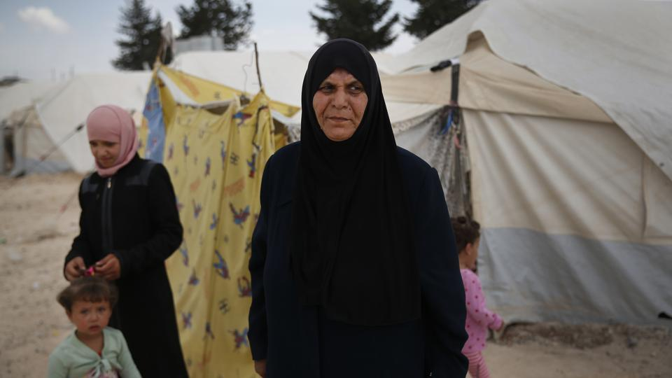 "Fathiya, the 61-year-old grandmother has tried unsuccessfully for a separate tent to give her son and his wife some privacy. In Douma, Maysaa began losing her balance as she gave what little food her husband brought home all to her children.""She wouldn't eat, to let her children eat,"" Fathiya said. This Ramzan, the 27-year-old is not fasting so that she can boost her diminished health. (Lefteris Pitarakis / AP)"