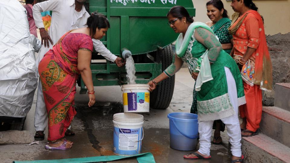 Residents filling water in buckets from a water tanker in Gurgaon.