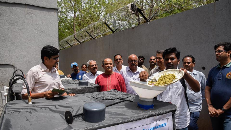 Alumni of BMCC inaugurate the machine which can convert waste food into biogas at the college on Monday.