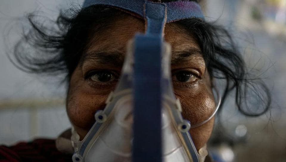 """Shiv Kumari, a patient at Kanpur's Murari Lal Chest Hospital suffers from breathing problems. """"Pollution, dust or smoke makes me breathless. I feel that I am choking. I cough and feel as if something sharp is pinching my throat,"""" she said. The city of three million people has been smarting since a World Health Organisation (WHO) report put Kanpur at the head of 14 Indian cities in the world's top 15 with the dirtiest air. (Chandan Khanna / AFP)"""