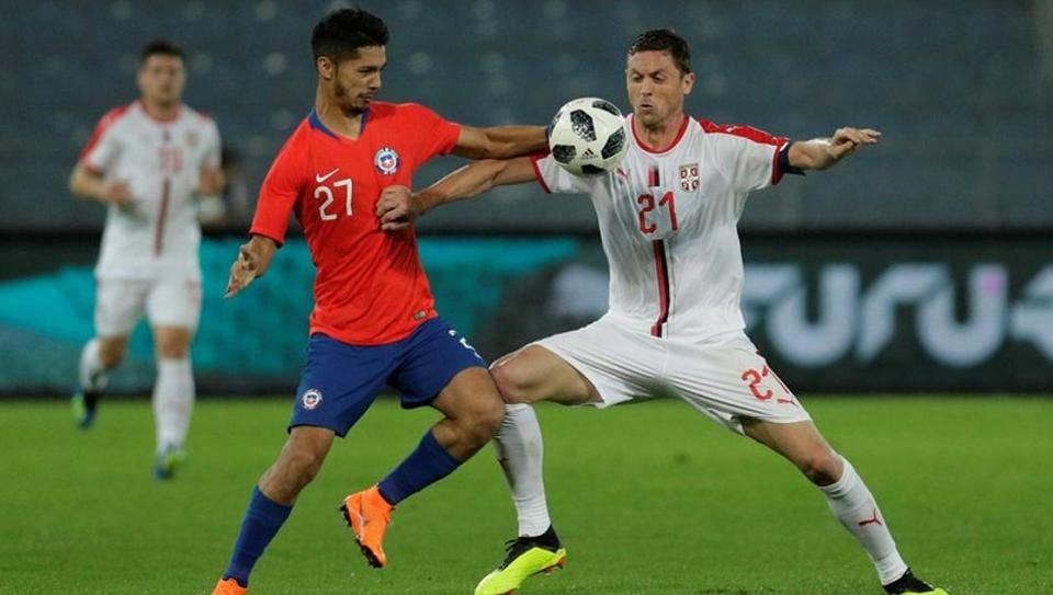 Chile's Jimmy Martinez in action with Serbia's Nemanja Matic in their international football friendly in Zurich on Monday.